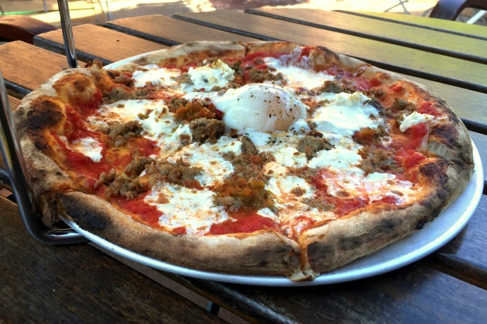 photo of sausage pizza with a slow-cooked egg from Brewer's Fork, Charlestown, MA