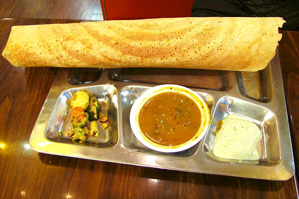 Photo of a dosa from the Dosa Factory, a Cambridge restaurant that has an instructional video within our site (via how2heroes).