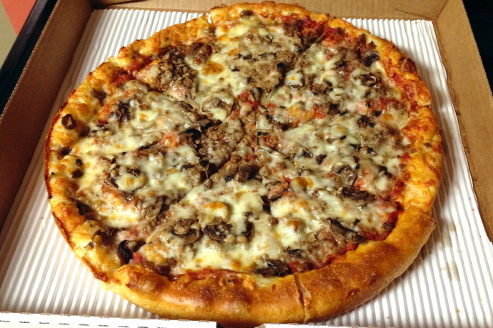 photo of a mushroom and hamburger pizza from New London Pizza, a sub shop and pizza place on Thoreau Street in Concord, MA
